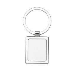 Chaveiro de metal quadrado com chapa central, verso liso.